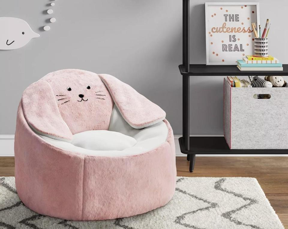 """<p>This <a href=""""https://www.popsugar.com/buy/Pillowfort-Character-Bean-Bag-Chair-Bunny-568684?p_name=Pillowfort%20Character%20Bean%20Bag%20Chair%20Bunny&retailer=target.com&pid=568684&price=60&evar1=moms%3Aus&evar9=25997679&evar98=https%3A%2F%2Fwww.popsugar.com%2Fphoto-gallery%2F25997679%2Fimage%2F46685331%2FPillowfort-Character-Bean-Bag-Chair-Bunny&list1=holiday%2Cgift%20guide%2Ckid%20shopping%2Choliday%20living%2Choliday%20for%20kids&prop13=api&pdata=1"""" class=""""link rapid-noclick-resp"""" rel=""""nofollow noopener"""" target=""""_blank"""" data-ylk=""""slk:Pillowfort Character Bean Bag Chair Bunny"""">Pillowfort Character Bean Bag Chair Bunny </a> ($60) is the ultimate spot for kids to sit and read a book or just listen to some music.</p>"""