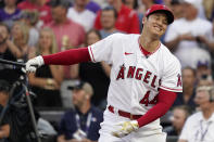 American League's Shohei Ohtani, of the Los Angeles Angeles, hits during the first round of the MLB All Star baseball Home Run Derby, Monday, July 12, 2021, in Denver. (AP Photo/Gabriel Christus)