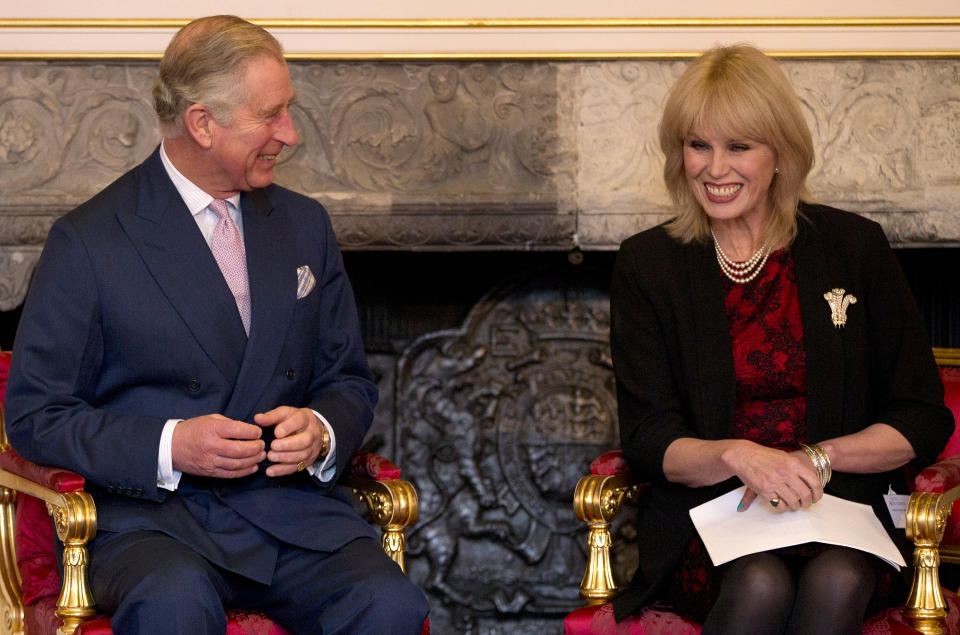 Britain's Prince Charles, the President, Arts and Business, smiles with actress Joanna Lumley during a ceremony to award The Prince of Wales Medal for Philanthropy for 2013, in London, Wednesday, Dec. 11, 2013.(AP Photo/Alastair Grant ,Pool)