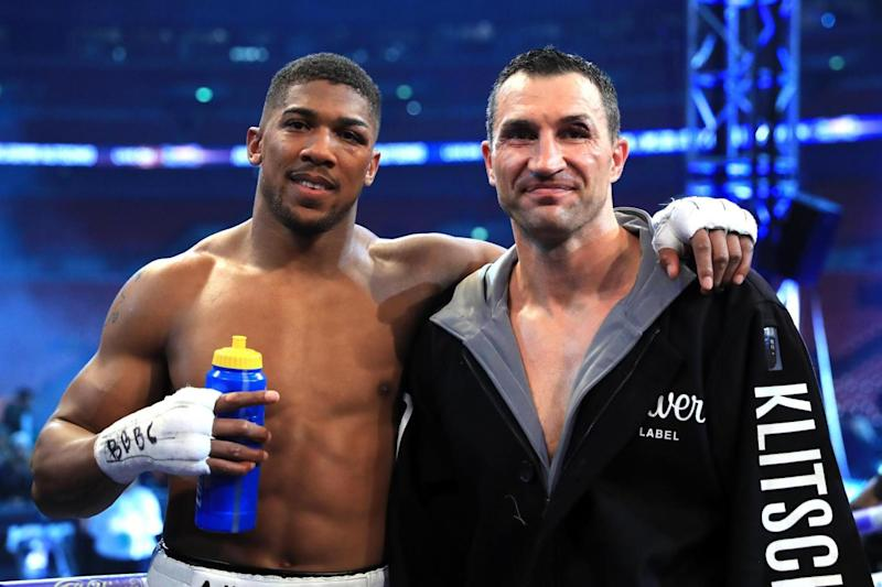 Stoppage: Wladimir Klitschko (right) was knocked down by Anthony Joshua (left) in the 11th round (Getty Images)