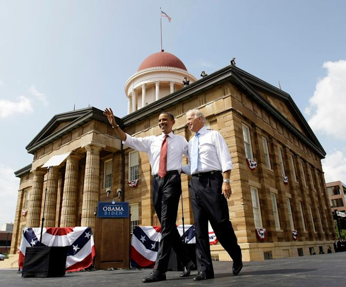 Barack Obama and Joe Biden greet crowds at a rally in Springfield, Ill., on Aug. 28, 2008.