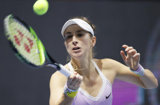 Belinda Bencic of Switzerland returns the ball to Maria Sakkari of Greece during the St. Petersburg Ladies Trophy-2020 tennis tournament match in St.Petersburg, Russia, Friday, Feb. 14, 2020. (AP Photo/Dmitri Lovetsky)