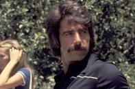 <p>Elliott may look different in his younger acting days, with flowing brunette hair, but of course his mustache was on point. </p>