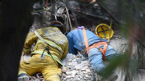 PHOTO: A firefighter and a rescuer search for survivors in Mexico City, Sept. 20, 2017, after an earthquake hit central Mexico on Sept 19, 2017. (Estrella Alfredo/AFP/Getty Images)