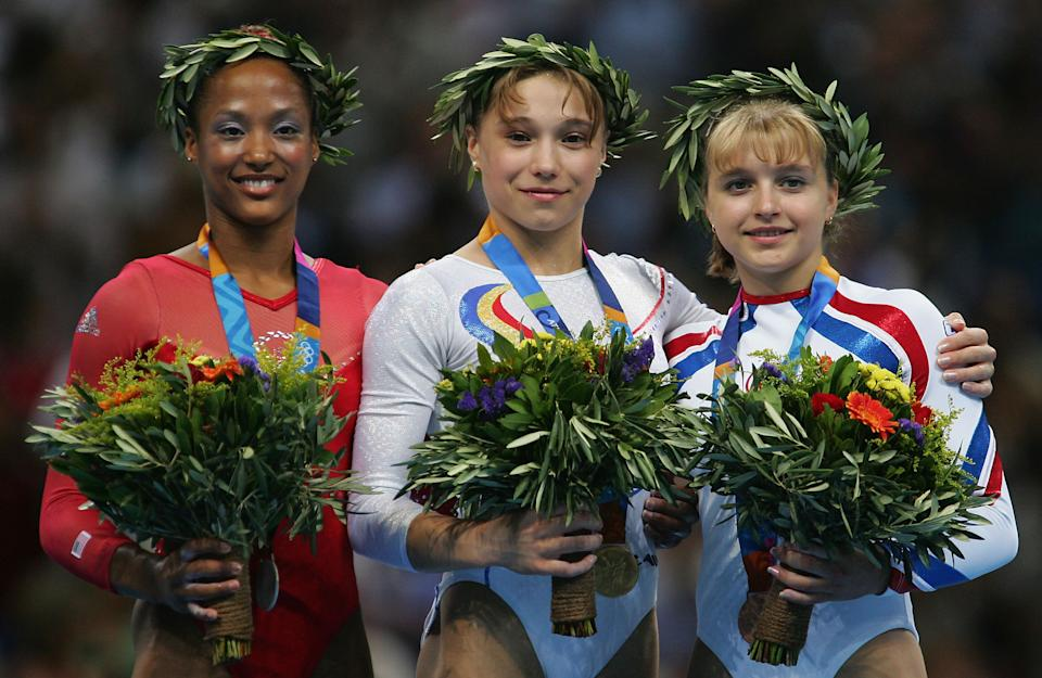 ATHENS - AUGUST 22:  Annia Hatch of the USA (silver), Monica Rosu of Romania (gold) and Elena Zamolodchikova of Russia (Bronze) stand on the dias after the medal ceremony for the women's artistic gymnastics vault event on August 22, 2004 during the Athens 2004 Summer Olympic Games at the Olympic Sports Complex Indoor Hall in Athens, Greece. (Photo by Chris McGrath/Getty Images)