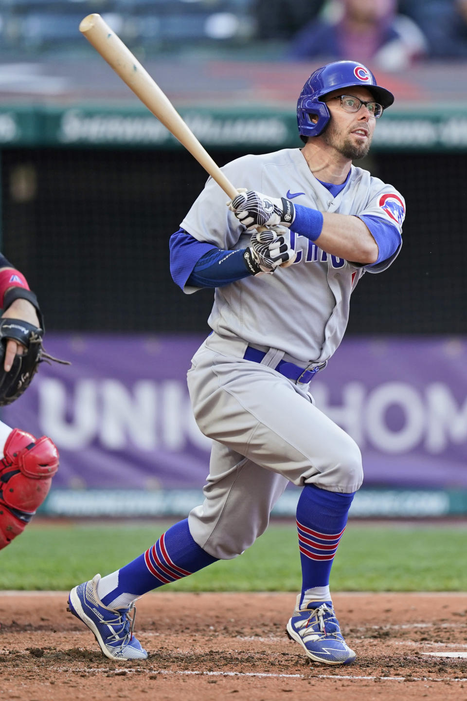 Chicago Cubs' Eric Sogard watches his ball after hitting a solo home run in the fifth inning of a baseball game against the Cleveland Indians, Tuesday, May 11, 2021, in Cleveland. (AP Photo/Tony Dejak)