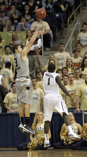 Oakland's Travis Bader (3) tries a three-point shot over Pittsburgh's Tray Woodall (1) in the first half of the NCAA college basketball game on Saturday, Nov. 17, 2012 in Pittsburgh. (AP Photo/Keith Srakocic)