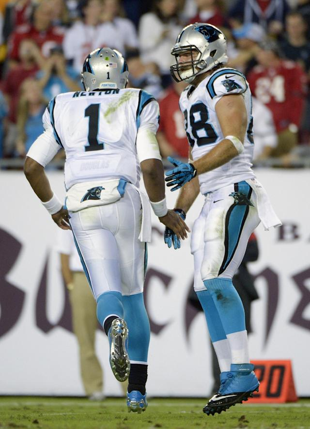 Carolina Panthers quarterback Cam Newton (1) congratulates tight end Greg Olsen (88) after Olsen caught a 1-yard pass for a touchdown against the Tampa Bay Buccaneers during the first half of an NFL football game in Tampa, Fla., Thursday, Oct. 24, 2013. (AP Photo/Phelan M. Ebenhack)