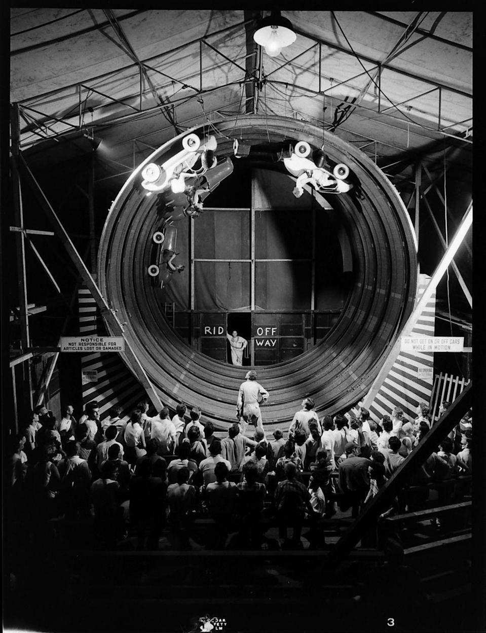 <p>You can see video of this ride in action: Not only did the cars roll around inside the looping track, the entire drum rotated in a circle, sending riders on a 30 mph spin.</p>