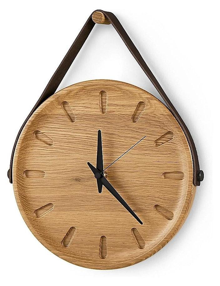 """This non-ticking timepiece is held in place by a leather strap that hangs over a wooden peg. Notably, the Toland Wall Clock has earned 5/5 stars from <em>all</em> its reviewers. It measures 11.5 inches in diameter. $179, Room & Board. <a href=""""https://www.roomandboard.com/catalog/home-decor/wall-clocks/toland-wall-clock"""" rel=""""nofollow noopener"""" target=""""_blank"""" data-ylk=""""slk:Get it now!"""" class=""""link rapid-noclick-resp"""">Get it now!</a>"""