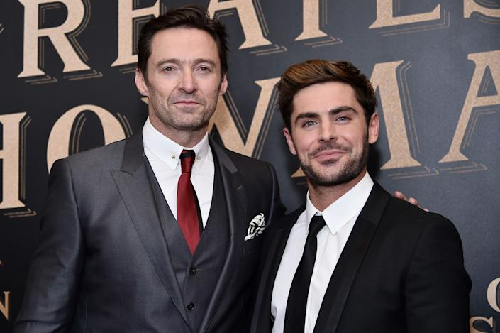 NEW YORK, NY - DECEMBER 08: Hugh Jackman and Zac Efron attend 'The Greatest Showman' World Premiere aboard the Queen Mary 2 at the Brooklyn Cruise Terminal on December 8, 2017 in the Brooklyn borough of New York City. (Photo by Steven Ferdman/Patrick McMullan via Getty Images)