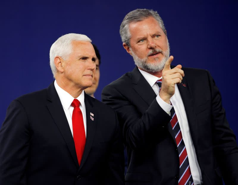 FILE PHOTO: Liberty University President Jerry Falwell Jr. and U.S. President Mike Pence at the school's commencement in Lynchburg, Virginia