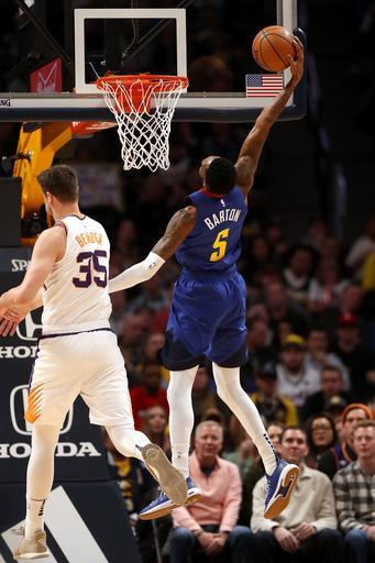 DENVER, COLORADO - JANUARY 25: Will Barton #5 of the Denver Nuggets dunks against Dragan Bender #35 of the Phoenix Suns in the first quarter at the Pepsi Center on January 25, 2019 in Denver, Colorado. (Photo by Matthew Stockman/Getty Images)