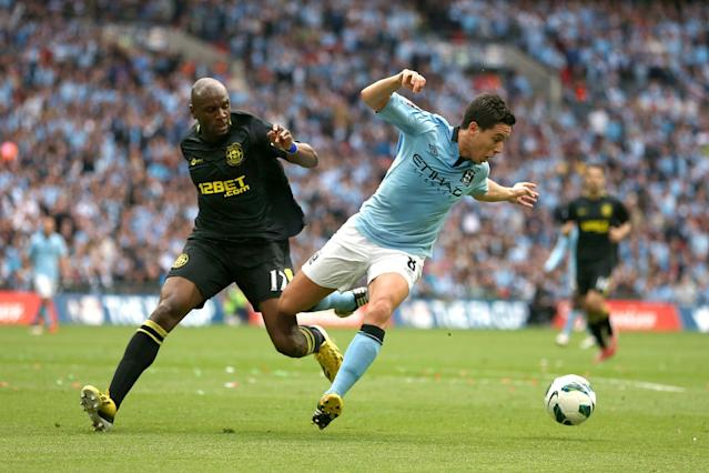Manchester City's Samir Nasri and Wigan Athletic's Emmerson Boyce (left) battle for the ball