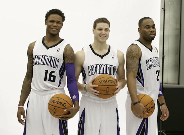 Sacramento Kings guards, from left, Ben McLemore, Jimmer Fredette and Marcus Thornton pose for photos during the team's NBA basketball media day in Sacramento, Calif., Monday, Sept. 30, 2013. (AP Photo/Rich Pedroncelli)