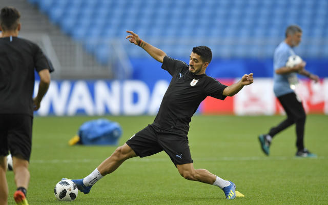 Uruguay's Luis Suarez exercises during Uruguay's official training on the eve of the group A match between Russia and Uruguay at the 2018 soccer World Cup at the Samara Arena in Samara, Russia, Sunday, June 24, 2018. (AP Photo/Martin Meissner)