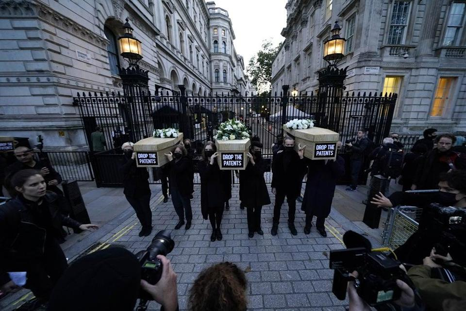 Campaigners carry coffins outside Downing Street in Westminster (Aaron Chown/PA) (PA Wire)