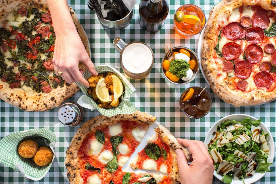 """<p>The only problem with finding pizza in London is that there's so many <a href=""""https://www.elle.com/uk/life-and-culture/culture/g30468805/best-italian-restaurants-london/"""" rel=""""nofollow noopener"""" target=""""_blank"""" data-ylk=""""slk:Italian restaurants"""" class=""""link rapid-noclick-resp"""">Italian restaurants</a> to choose from. </p><p>Whether you're sharing a 12 inch pizza from <a href=""""http://www.homeslicepizza.co.uk/"""" rel=""""nofollow noopener"""" target=""""_blank"""" data-ylk=""""slk:Homeslice"""" class=""""link rapid-noclick-resp"""">Homeslice</a> in Covent Garden or you're savouring every last mouthful of a soft pillowy sourdough base in Forest Hill's <a href=""""http://www.bona-sourdough.co.uk/"""" rel=""""nofollow noopener"""" target=""""_blank"""" data-ylk=""""slk:Bona"""" class=""""link rapid-noclick-resp"""">Bona</a>, having a pizza with friends in the capital is possibly one of the <a href=""""https://www.elle.com/uk/life-and-culture/g26270508/vintage-celebrities-eating-pizza/"""" rel=""""nofollow noopener"""" target=""""_blank"""" data-ylk=""""slk:greatest meals on earth"""" class=""""link rapid-noclick-resp"""">greatest meals on earth</a> (ok, unless you're in Italy).</p><p>Which is why we've taken it upon ourselves to taste as many as we can in order to give you a comprehensive list of the best pizza in London.</p><p>So whether you want to make like <a href=""""https://www.elle.com/uk/life-and-culture/a23112331/bella-hadid-pink-corset-the-weeknd-pizza-ice-cream-date/"""" rel=""""nofollow noopener"""" target=""""_blank"""" data-ylk=""""slk:Bella Hadid"""" class=""""link rapid-noclick-resp"""">Bella Hadid</a> and eat a pizza cake – courtesy of designer <a href=""""https://www.elle.com/uk/fashion/a27695058/alexander-wang-pete-davidson-kendall-jenner-kaia-gerber/"""" rel=""""nofollow noopener"""" target=""""_blank"""" data-ylk=""""slk:Alexander Wang"""" class=""""link rapid-noclick-resp"""">Alexander Wang</a> – to celebrate <a href=""""https://www.elle.com/uk/life-and-culture/a29422439/bella-hadid-23rd-birthday-party/"""" rel=""""nofollow noopener"""" target=""""_blank"""" data-ylk=""""slk:a birthday"""" class=""""link rapid-nocli"""