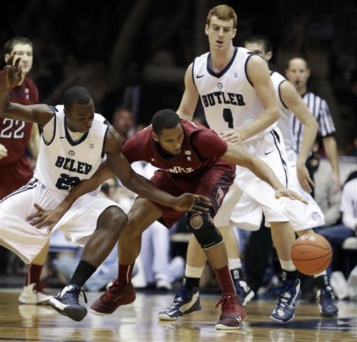 Temple forward Rahlir Hollis-Jefferson, right, drives against Butler forward Khyle Marshall during the first half of an NCAA college basketball game Saturday, Jan. 26, 2013, in Indianapolis. (AP Photo/Darron Cummings)