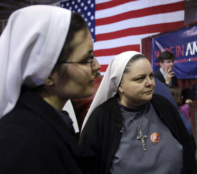 Sisters Maria Claire, left, and Catherine Lynn, right, visit and watch election results at Republican presidential candidate, former Pennsylvania Sen. Rick Santorum's election night party at Steubenville High School, Tuesday, March 6, 2012, in Steubenville, Ohio. (AP Photo/Eric Gay)