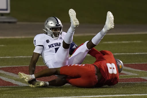 Nevada wide receiver Romeo Doubs (7) scores a touchdown over New Mexico cornerback Donte Martin (8) during the second half of an NCAA college football game Saturday, Nov. 14, 2020, in Las Vegas. (AP Photo/John Locher)