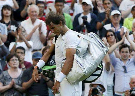 Rafael Nadal of Spain prepares to walk off court after losing his match against Dustin Brown of Germany at the Wimbledon Tennis Championships in London