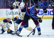 Colorado Avalanche left wing J.T. Compher (37) steals the puck from Buffalo Sabres left wing Conor Sheary (43) during the first period of an NHL hockey game Saturday, March 9, 2019, in Denver. (AP Photo/Jack Dempsey)