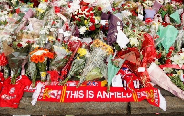 Floral tributes outside Anfield before a memorial service