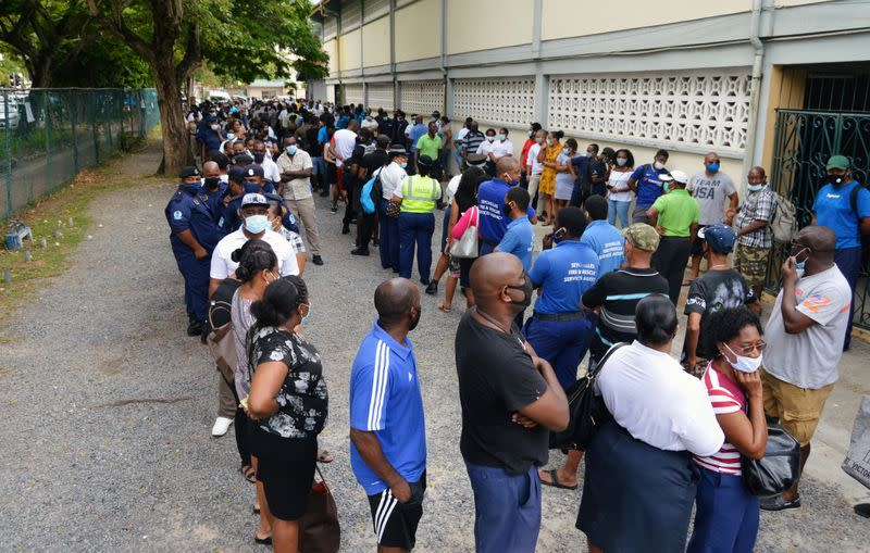 Voters queue at a polling station to cast their ballots during the presidential and parliamentary elections in Victoria