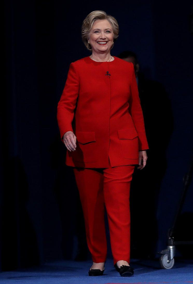 Hillary Clinton strides onstage for her first presidential debate with Donald Trump in a bright-red suit by Ralph Lauren. (Photo: Getty)