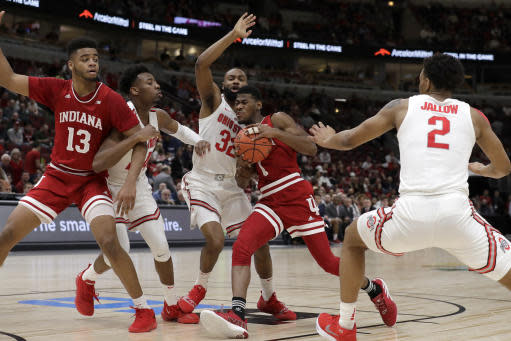 Indiana's Aljami Durham (1) drives against Ohio State's Keyshawn Woods (32) during the first half of an NCAA college basketball game in the second round of the Big Ten Conference tournament, Thursday, March 14, 2019, in Chicago. (AP Photo/Nam Y. Huh)