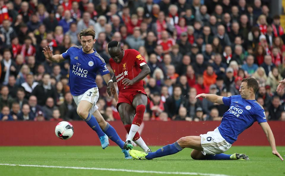 Liverpool's Sadio Mane in action with Leicester City's Jonny Evans (right) and Ben Chilwell last season.