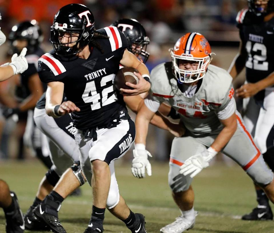 Trinity fullback Joseph Luna (42) attacks the middle of the line during the second half of a high school football game at Pennington Field in Bedford, Texas, Friday, Oct. 04, 2019. Trinity defeated San Angelo Central 49-24. (Special to the Star-Telegram Bob Booth)
