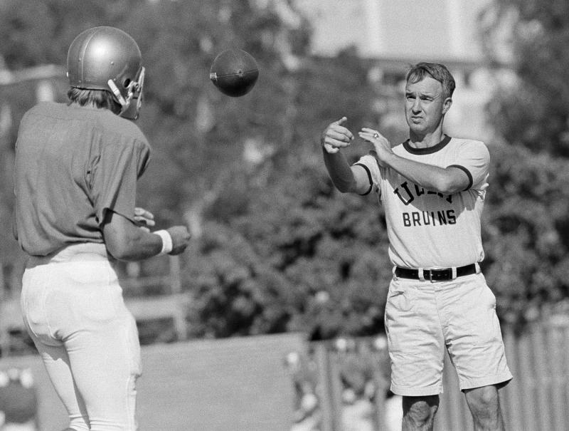 UCLA quarterback Mark Harmon son of former Michigan Heisman Trophy winner Tom Harmon, works out with Coach Pepper Rodgers on Tuesday, Sept. 13, 1972 in Los Angeles. After UCLA?s upset win over Nebraska lat week, Rodgers said ?Mark Harmon?s opening-game performance was better then that of the other quarterbacks I?ve had.? (AP Photo/GB)