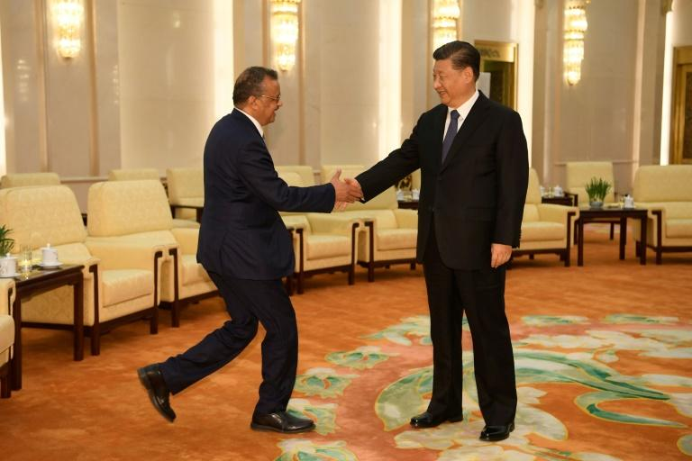 World Health Organization Director-General Tedros Adhanom Ghebreyesus shakes hands with Chinese President Xi jinping before a meeting at the Great Hall of the People in Beijing in January 2020