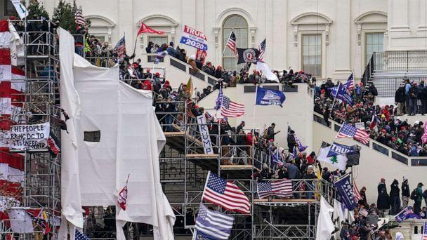 PHOTO: Trump supporters gather outside the U.S. Capitol, Jan. 6, 2021, in Washington. (John Minchillo/AP)