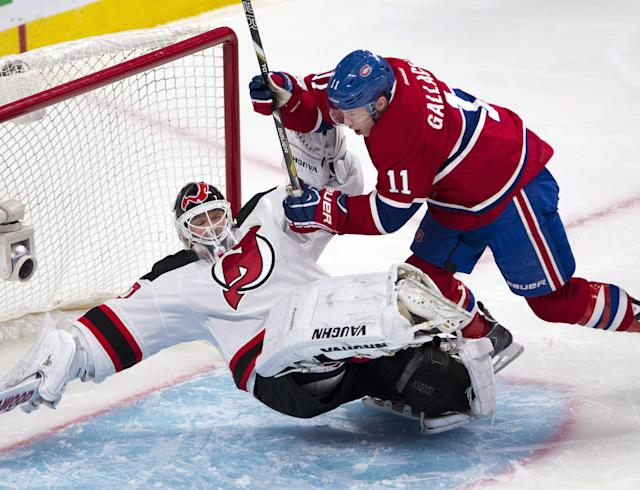 Montreal Canadiens right wing Brendan Gallagher (11) runs over New Jersey Devils goalie Martin Brodeur (30) during the first period of an NHL hockey game Tuesday, Jan. 14, 2014, in Montreal. (AP Photo/The Canadian Press, Ryan Remiorz)