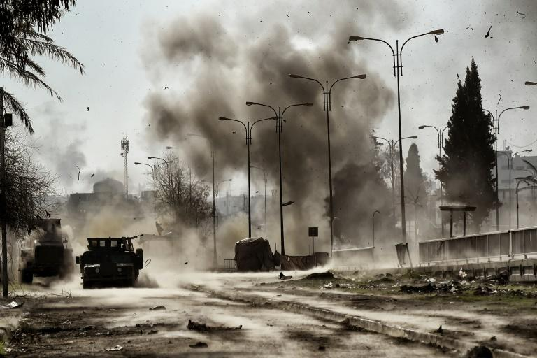 Smoke billows following a car bomb explosion as Iraqi forces clash with Islamic State (IS) group fighters in Mosul, northern Iraq on March 5, 2017, during an offensive to retake the western parts of the city from the jihadists