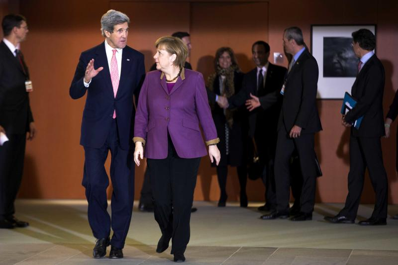 German Chancellor Angela Merkel, right, welcomes United States Secretary of State John Kerry, left, for a meeting at the chancellery in Berlin, Tuesday, Feb. 26, 2013.  Berlin is the second stop in Kerry's first trip overseas as Secretary of State.  (AP Photo/Markus Schreiber)