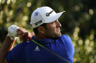 Jon Rahm, of Spain, watches his tee shot on the 15th hole during the third round of the Masters golf tournament Saturday, Nov. 14, 2020, in Augusta, Ga. (AP Photo/David J. Phillip)