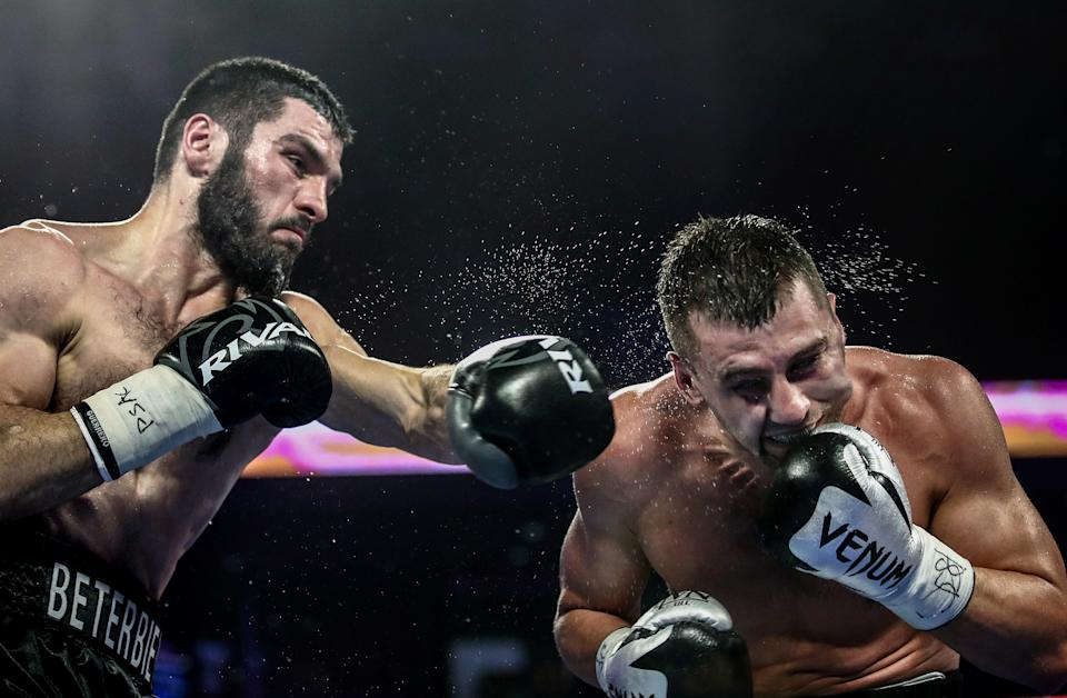 PHILADELPHIA, UNITED STATES - OCTOBER 19, 2019: IBF belt-holder Artur Beterbiev of Russia (L) and WBC titlist Oleksandr Gvozdyk of Ukraine compete in a light heavyweight world title unification boxing fight at the Liacouras Center in Philadelphia, Pennsylvania, United States; Beterbiev won the bout. Valery Sharifulin/TASS (Photo by Valery Sharifulin\TASS via Getty Images)