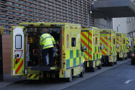 A patient arrives in an ambulance outside the Royal London Hospital in east London, Monday, Jan. 25, 2021, during England's third national lockdown since the coronavirus outbreak began. The U.K. is under an indefinite national lockdown to curb the spread of the new variant, with nonessential shops, gyms and hairdressers closed, most people working from home and schools largely offering remote learning. (AP Photo/Matt Dunham)