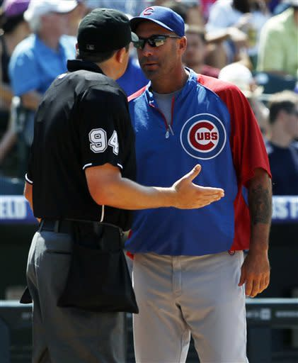 Chicago Cubs manager Dale Sveum, right, argues call with home plate umpire Lance Barrett, left, while facing the Colorado Rockies in the fourth inning of a baseball game in Denver, Sunday, July 21, 2013. (AP Photo/David Zalubowski)