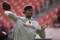FILE - In this Dec. 22, 2019, file photo, Washington Redskins quarterback Dwayne Haskins works out prior to an NFL football game against the New York Giants, in Landover, Md. A new name must still be selected for the Washington Redskins football team, one of the oldest and most storied teams in the National Football League, and it was unclear how soon that will happen. But for now, arguably the most polarizing name in North American professional sports is gone at a time of reckoning over racial injustice, iconography and racism in the U.S. (AP Photo/Alex Brandon, File)