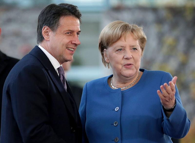 German Chancellor Angela Merkel, right, and Italy's Prime Minister Giuseppe Conte, left, shake hands prior to a meeting at the chancellery as part of the 'Compact with Africa' conference in Berlin, Germany, Tuesday, Nov. 19, 2019. (AP Photo/Michael Sohn) (Photo: ASSOCIATED PRESS)