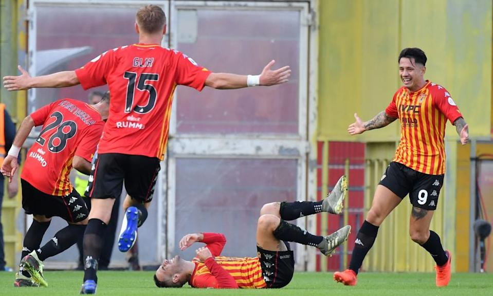 Roberto Insigne (centre) celebrates opening the scoring for Benevento.