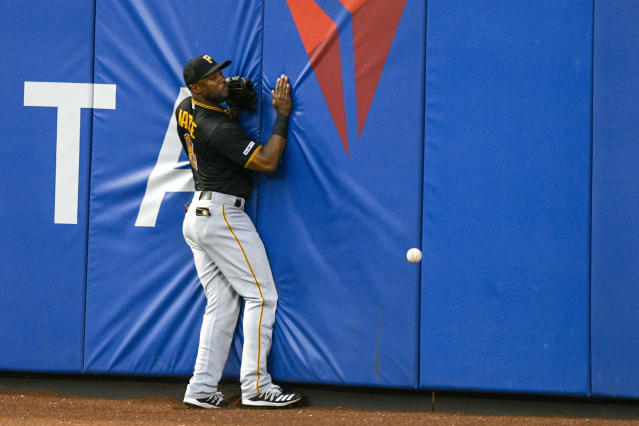 Pittsburgh Pirates center fielder Starling Marte (6) can not make a catch on a hit by New York Mets shortstop Amed Rosario (1) during the third inning of a baseball game, Friday, July 26, 2019, in New York. (AP Photo/Corey Sipkin)