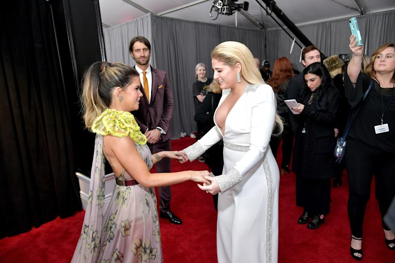 Truly, what is happening? Why would Meghan Trainor attempt a pantsuit, and why does Maren Morris's otherwise pretty dress have a giant neon yellow growth on the shoulder?