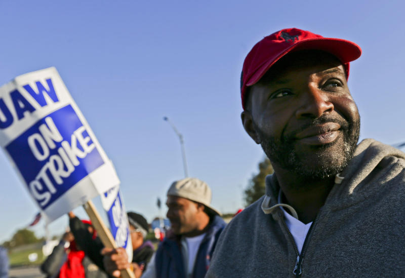 Temp Trim worker Darsuan Hall, of Florissant, looks towards oncoming traffic while standing on the picket line outside the General Motors plant in Wentzville, Mo., on Tuesday, Oct. 22, 2019. United Auto Workers around the country will be voting on whether to accept or reject the recent offer made to the union by GM in the coming week. (Troy Stolt/St. Louis Post-Dispatch via AP)