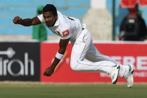 Sri Lanka's Vishwa Fernando bowls on the way to taking two Pakistan wickets in three balls before lunch on the first day of the second Test in Karachi